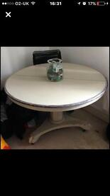 Round solid wood table. Top comes of for easy transportation