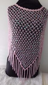 A pretty pink and seqin poncho. One size. Looks lovely over black evening dress.new.
