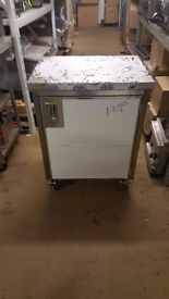 STAINLESS STEEL CUPBOARD WITH WHEELS. SMALL TABLE