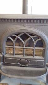 Gas wood burning stove type heater