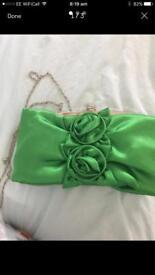 New green clutch bag