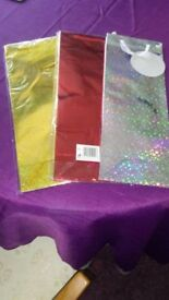 s pack of 3 sparkly bottle bags gold.silver and red