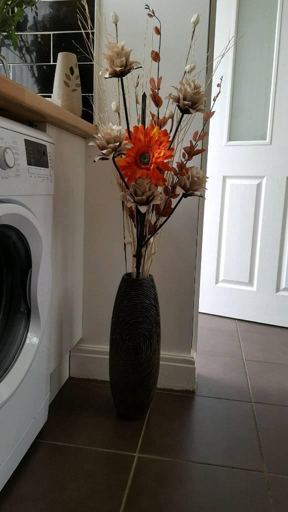 Dark brown engraved vase and flowers