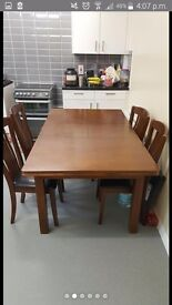 Extendable Dark Wood Dining table + 4 chairs