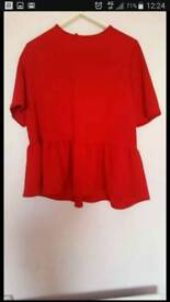 Peplum red top. Size 16. Brand new.