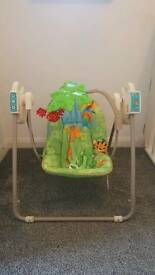 Fisher price rainforest carry along swing