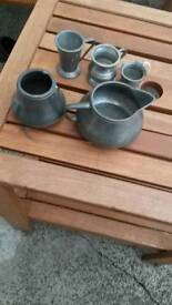 Vintage pewter measure jugs