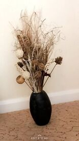 Stunning Large brown wooden vase with a mixture of artificial flowers and bits
