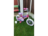 """Girls 12.5"""" lip gloss bike with stabilisers can diliver for a small charge"""