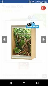 Vivarium with uv, heat bulb, cage, thermostat accessories.