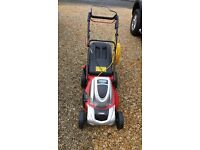 Cobra electric self propelled lawn mower hardly used.