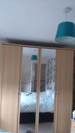 Large Beech 4 door Wardrobe and 2 bedside cabinets