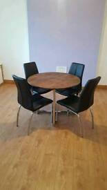 Stunning wooden table chrome legs with 4 black leather chairs