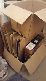 Packing cardboard boxes. Moving home. Packaging. Large extra large and garment boxes