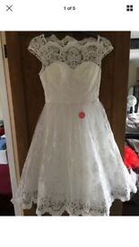 Brand new with tags CHI CHI London wedding dress size 12