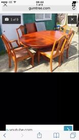 MALOGANY EXTENDABLE DINING TABLE AND 7 CHAIRS
