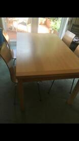 Solid extending table and chairs.