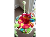 Jumperoo - Fisher Price rainforest theme.