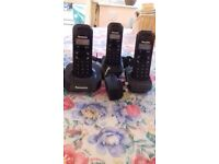 Panasonic phone with base unit and 2 separate handsets.