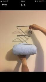 Wall mounted towels holder
