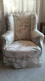 Small antique winged armchair