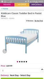 Blue toddler bed frame (no mattess)