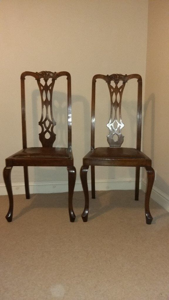 Pair of solid wood chairsin Norwich, NorfolkGumtree - Pair of solid wood dining/occasional chairs. slight play in both and repair to underside of one