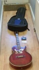 "Ozark 3387R electro acoustic ""Eagle Guitar""in red wine burst wood grain colour."