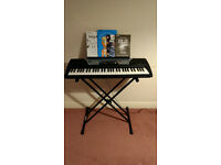 Yamaha PSR -175 with stand, manual and music books, fully working and good condition.