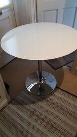 Round white pedestal table