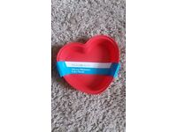 Silicone heart for baking unused