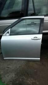 Suzuki swift passenger door