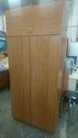Double door wardrobe with upper storage cupboard