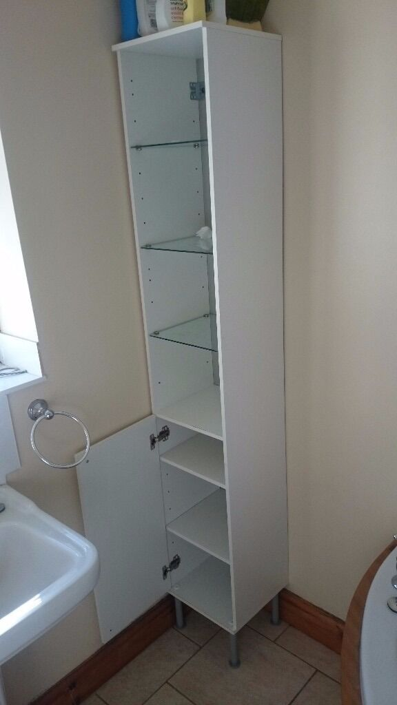 Bathroom high cabinet woth shelves and doors