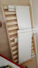 Two white toddler beds