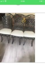 3 dining chairs and large black glass oval table to match