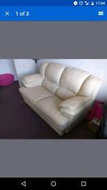 Two seater cream leather sofa.