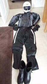 Female Motorcycle clothing gear including Arai Helmet, Spada Jacket, Trousers, Boots, & Gloves