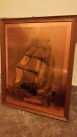 Large copper picture of a ship