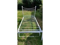 White single metal bedframe with guest bed