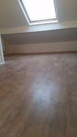 Laminate floor with underlay and beading