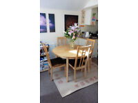 Extending IKEA dining table with four chairs
