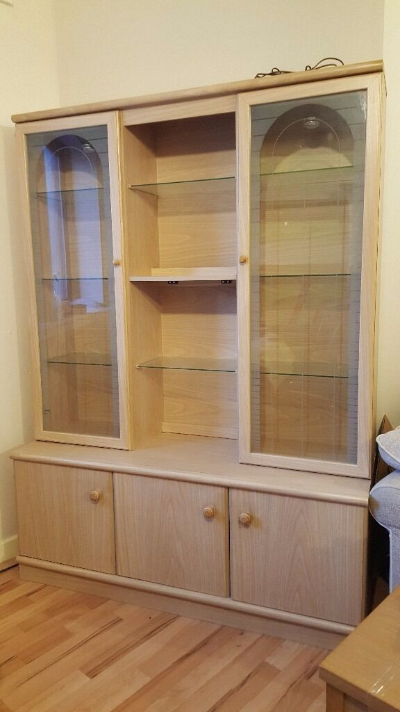 Urgent! Light Up Display Cabinet/ Dresser, has plenty of space for storage and glass shelving