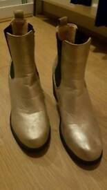 Golden ankle boots