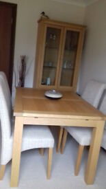 wooden dinning table complete with six chairs, 1200-900 extendable to 1600. one dinning cabinet.