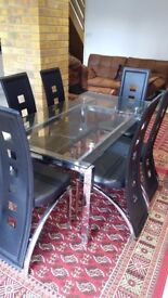 Like new glass table and six Harveys leather chairs