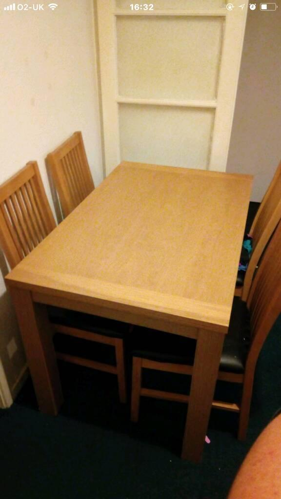 Pine color table with 4 chairs