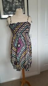 Bundle of Summer Clothes Including Dresses, Tunics, Skirts and Tops. Size 8-10