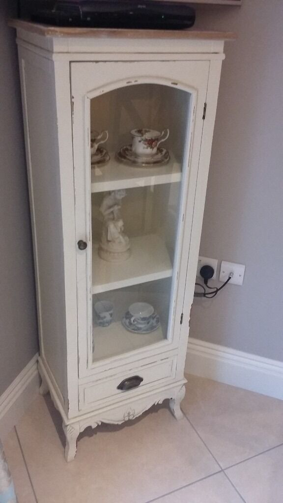 Cream Shabby chic tall display cabinet and side tablein Newry, County DownGumtree - Matching display cabinet and side table in cream with light wood top. Both good as new. £75 to buy as a set