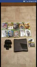 Xbox 360 250gb with 2 wireless pads, charging station and games